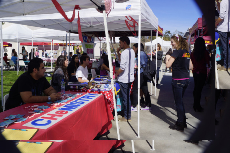 Student clubs set up informational booth to answer questions to promote and recruit new members. (Photograph by Marivel Guzman)