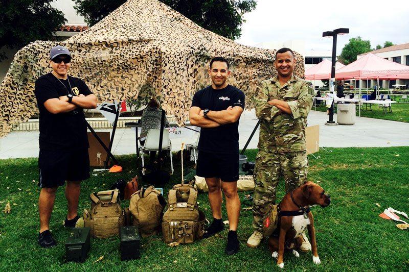 Saddleback students (L to R), Oscar Roman, Kamran Sadaghiani, Juan Valdez, and Midas participate in Veterans Week. (Photo/Sharon Tayler)